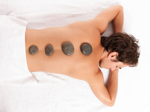 hot rocks on man's back